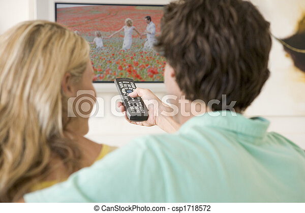 Couple in living room watching television - csp1718572