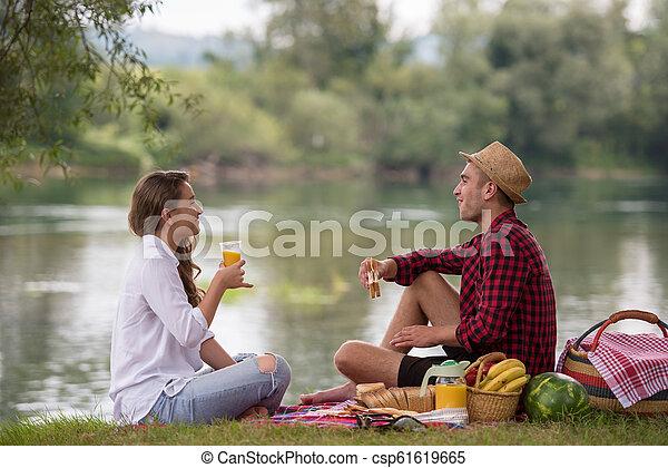 Couple in love enjoying picnic time - csp61619665