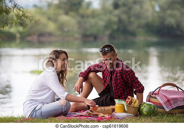 Couple in love enjoying picnic time - csp61619606