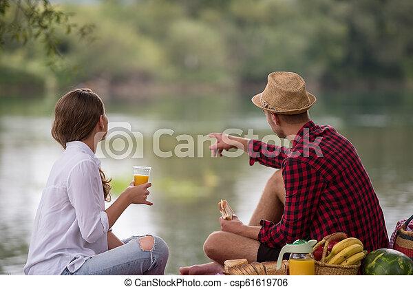 Couple in love enjoying picnic time - csp61619706