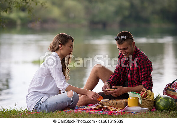 Couple in love enjoying picnic time - csp61619639