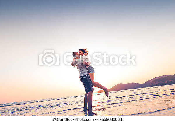 Couple in love having romantic tender moments at sunset on the beach. - csp59638683