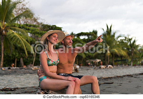 Couple in love having romantic tender moments at sunset on the beach - csp63165346