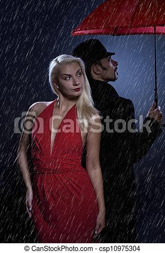 Couple in love standing under umbrella - csp10975304