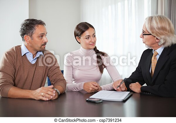 Couple in meeting with a financial planner - csp7391234