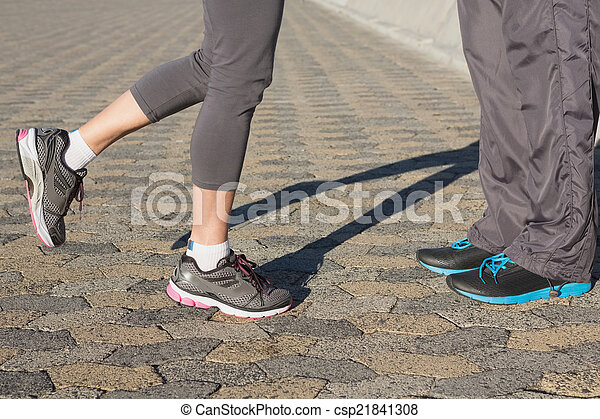 Couple in running shoes facing - csp21841308
