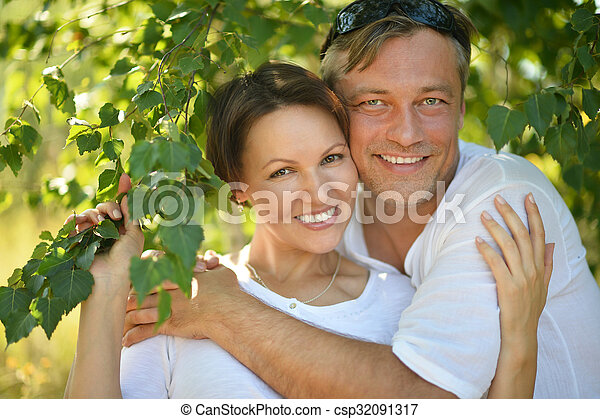 couple  in summer park - csp32091317