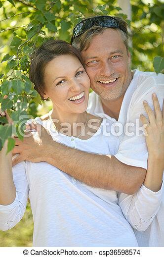 couple  in summer park - csp36598574