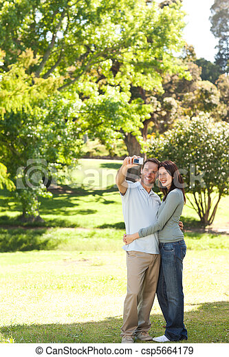 Couple in the park - csp5664179