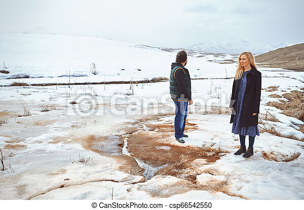 Couple in the winter landscape - csp66542550