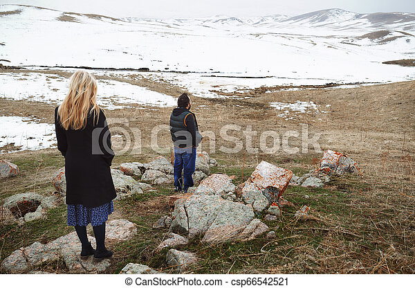 Couple in the winter landscape - csp66542521