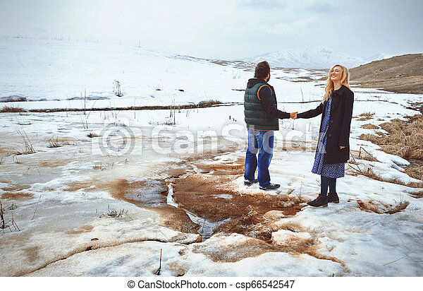 Couple in the winter landscape - csp66542547