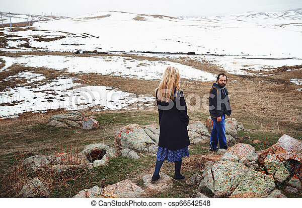 Couple in the winter landscape - csp66542548