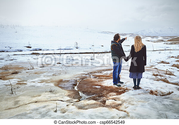 Couple in the winter landscape - csp66542549