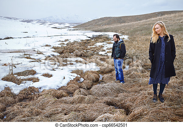 Couple in the winter landscape - csp66542501