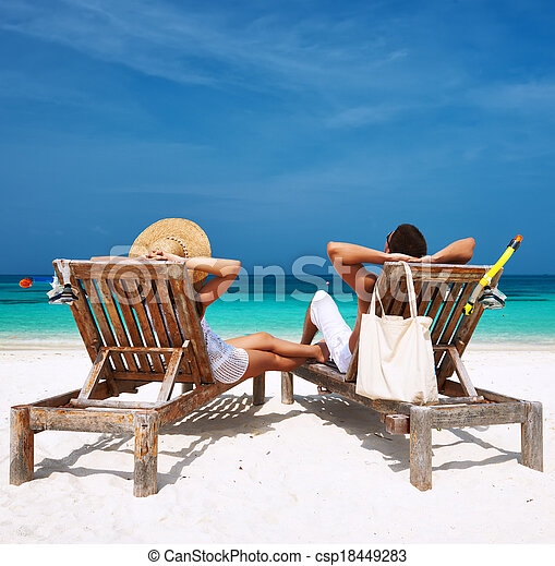 Couple in white relax on a beach at Maldives - csp18449283