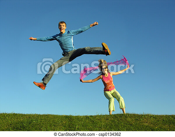 couple jump on grass - csp0134362