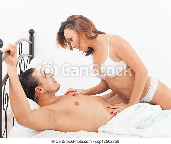 Couple kissing in bed - csp17502750
