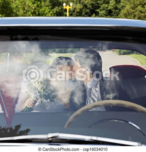 Couple kissing in car - csp16034010