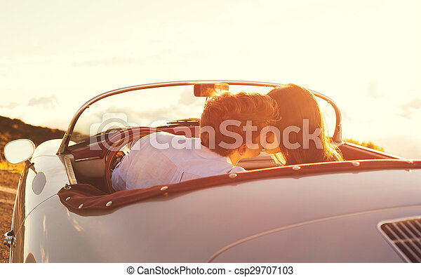 Couple Kissing in Classic Vintage Sports Car - csp29707103