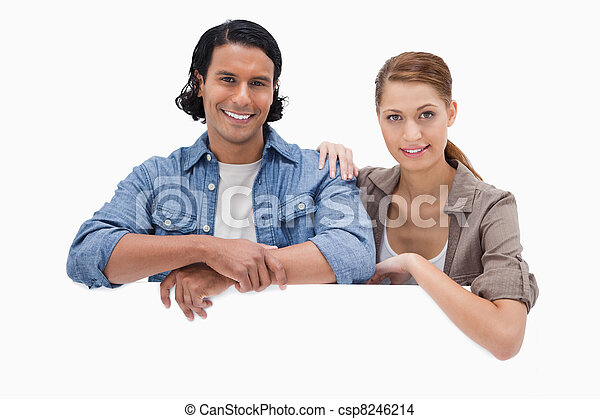 Couple leaning on blank wall - csp8246214