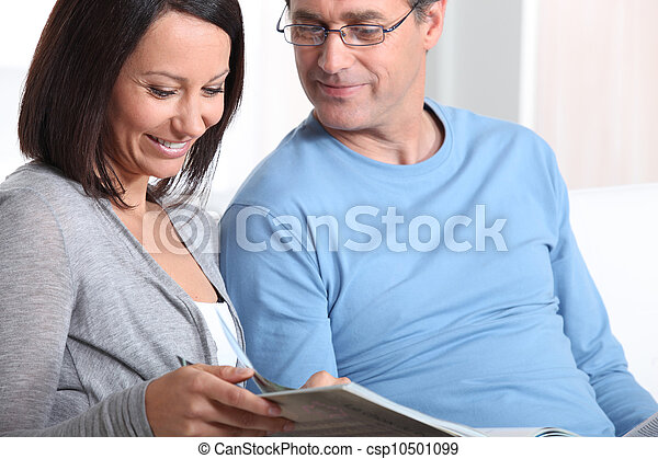 Couple looking at a photo album - csp10501099
