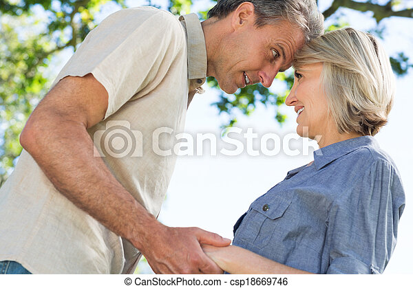 Couple looking at each other in park - csp18669746