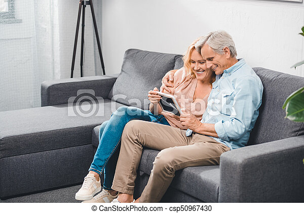 couple looking at photo frame - csp50967430