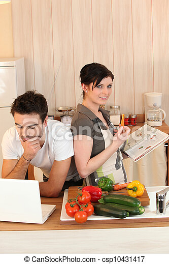 Couple looking at recipes - csp10431417