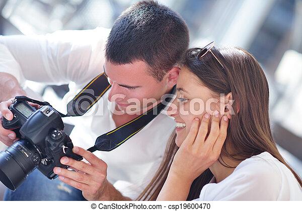 couple looking photos on camera - csp19600470