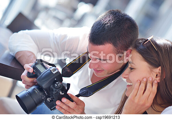 couple looking photos on camera - csp19691213