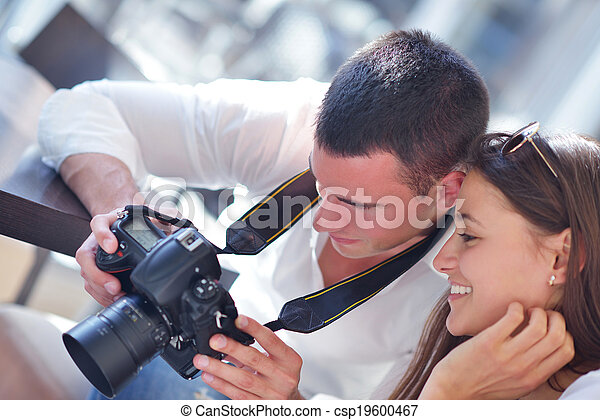 couple looking photos on camera - csp19600467