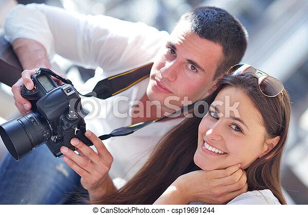 couple looking photos on camera - csp19691244
