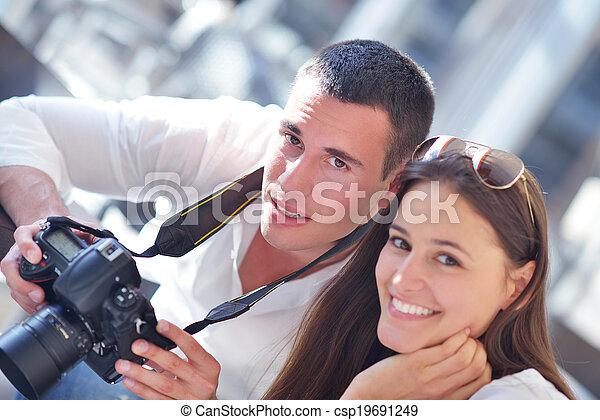 couple looking photos on camera - csp19691249