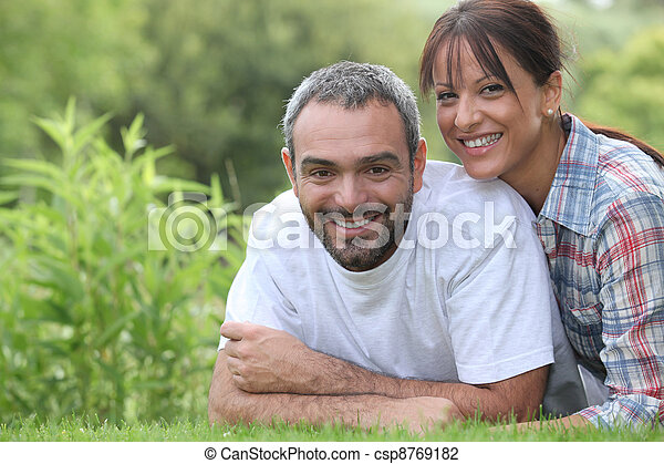 Couple lying in grass - csp8769182