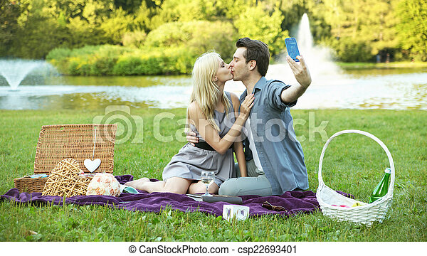 Couple making the kissing selfie - csp22693401