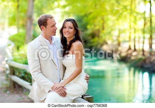couple of lovers in love in park river hug - csp7756368