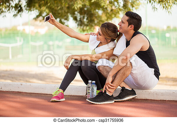 Couple of runners taking a selfie - csp31755936