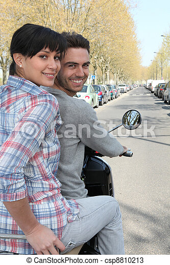 Couple on a scooter - csp8810213