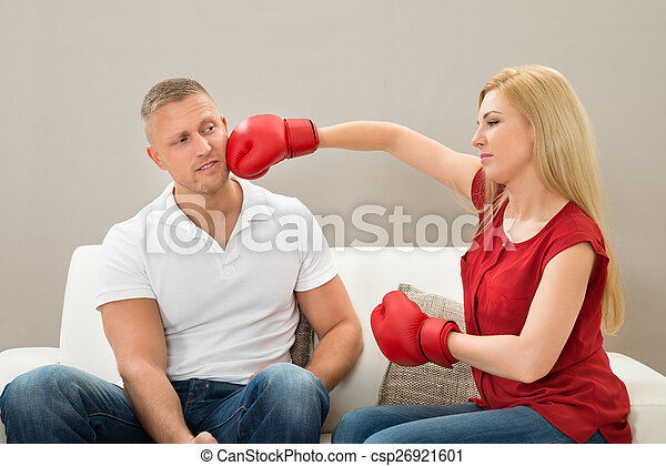 Couple On Sofa Fighting With Boxing Gloves - csp26921601