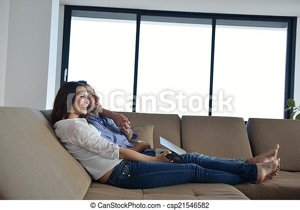 Couple on sofa - csp21546582