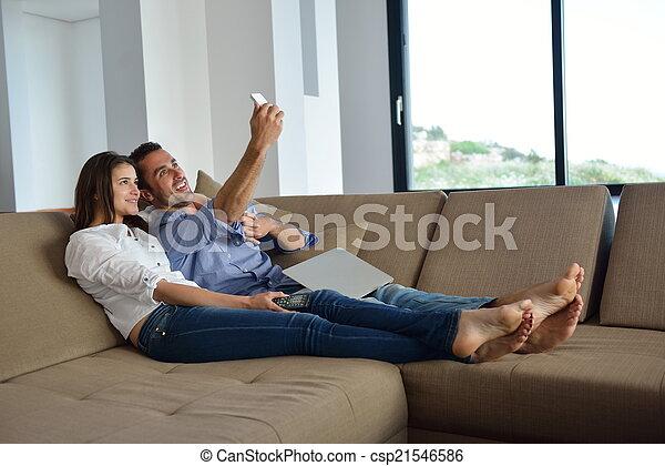 Couple on sofa - csp21546586