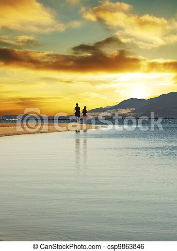Couple on sunset - csp9863846