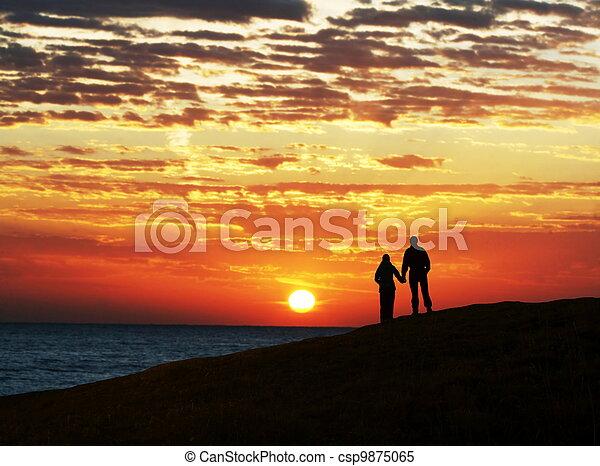 Couple on sunset - csp9875065