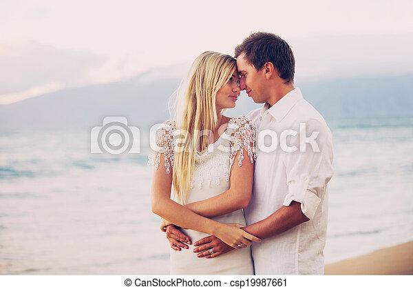 Couple on the beach sunset - csp19987661
