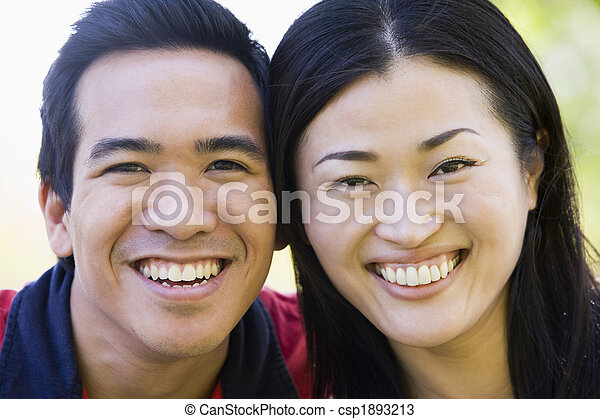 Couple outdoors smiling - csp1893213