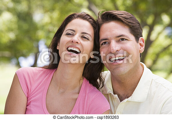 Couple outdoors smiling - csp1893263