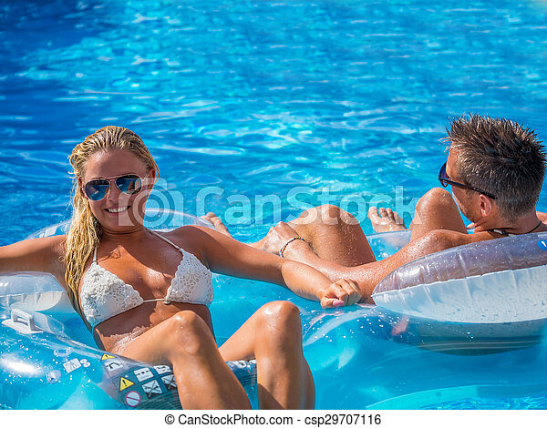 Couple Outside Relaxing In Swimming Pool - csp29707116