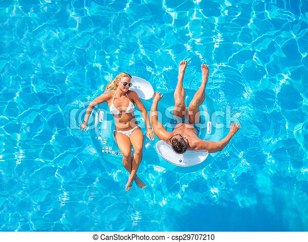 Couple Outside Relaxing In Swimming Pool - csp29707210