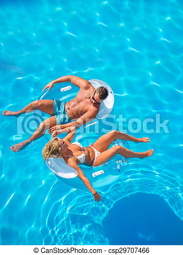 Couple Outside Relaxing In Swimming Pool - csp29707466